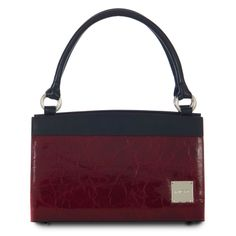 *Miche Canada* Mmmm... rich glossy cerise-red faux leather gives the Claire Wrap-Around Shell for Classic Bags an unmistakable aura of class. Need an exceptionally professional look for that important working lunch? Just put Claire on your arm and you're all set. Chic top detail in black and oversized logo plate complete the effect.