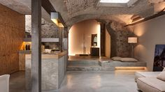 Conceiving a new typology of promenade architecturale, Gus Wüstemann Architects has renovated a multi-family house in Zurich with free-flowing spaces along the natural stone walls. Creative Architecture, Industrial Architecture, Architecture Photo, Amazing Architecture, Zurich, Natural Stone Wall, Adaptive Reuse, Cool Office, Loft