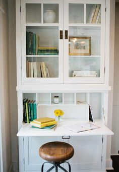 Cabinets and a desk, painted white. Cramped Kitchen Makeover - American Dream Builders Makeover - House Beautiful