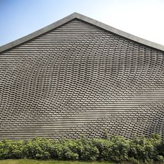 The architects used an algorithm to specify nine different brick types, which were laid by hand to create the wave-like texture across each wall.