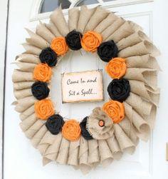 halloween wreath. I love the burlap and fabric flowers