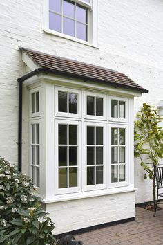 A bay window with flush casement windows in Off-White and with astragal glazing bars. Manufactured in Engineered European Redwood. Timber Windows, Windows And Doors, Bay Windows, French Casement Windows, Bay Window Exterior, Traditional Windows, Custom Window Treatments, Window Design, House Front
