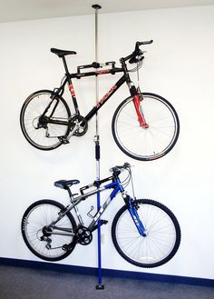 "Features:  -Dual bike storage rack.  -Ceiling to floor freestanding mount.  Product Type: -Bike Rack.  Location: -Ceiling Mount/Free Standing. Dimensions:  Overall Height - Top to Bottom: -58"".  Overa"