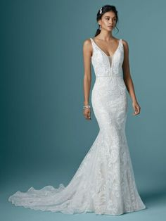 """Maggie Sottero - HENRIETTA, Try this unique lace mermaid wedding dress for a transformative """"Yes! That is, only if you're into gorgeous texture and ultra-chic details in an undeniably flattering silhouette. Lace Mermaid Wedding Dress, White Wedding Dresses, Designer Wedding Dresses, Sheath Wedding Dresses, Wedding Dresses Fit And Flare, Flattering Wedding Dress, Fitted Wedding Gown, Tulle Wedding, Gown Wedding"""