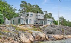 På en klippa vid havet... - Moderna Hus
