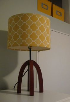 Spray paint living room lamps and recover shades. How-to for recovering a lamp shade. Be mindful of what fabric and bulb you choose. Soft white bulbs will give off a yellowish hue and alter colors.