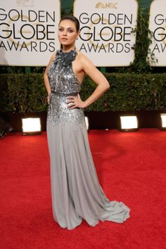 Mila Kunis in a Gucci One Premiere halter neck gown at the 71st Annual Golden Globes