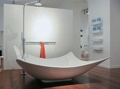 umm...WHY haven't they made tubs like this more often? i hate the standard bath tub...i'm small & i can't ever get comfortable in one, so i can't imagine being average-sized! this tub would be fantastic.