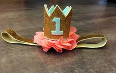 A personal favorite from my Etsy shop https://www.etsy.com/listing/291729737/coral-gold-mint-first-birthday-crown