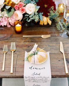 Napkin menu + #gold flatware | photo @austingros, event design + planning + flowers + paper goods @bigevents, catering @kristenwinston, menu napkins @sideshowsignco, flatward @12thTable, #calligraphy @marydeaton #onRuffled #ruffledblog #napkinmenus #placesettings #tnwedding #nashville #weddings