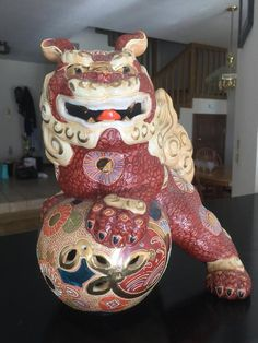 Vibrant mid-century ceramic (fu) foo dog /lion with hand painted gold highlights, gilding, and all over moriage decoration. Very minor wear and tear. See photos.  These ferocious vintage Japanese foo dog shishi lions are an excellent example of colorful Kutani style moriage porcelain Japanese Foo Dog, Vintage Japanese, Fu Dog, Porcelain Signs, Gold Highlights, Lions, Mid Century, Vibrant, Hand Painted