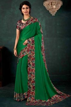 Green chiffon saree with black satin blouse. Embellished with floral print embroidery. Saree with Round Neck, Short Sleeve. It comes with unstitched blouse. Chiffon Saree, Silk Sarees, Traditional Sarees, Saree Styles, Blouse Online, Saree Collection, Saree Blouse, Designer Wear, Black Satin