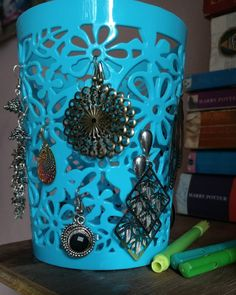 Turned a pencil stand into a earring holder by using the empty spaces or niches...