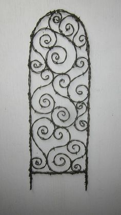 Random Barbed Wire Spirals Trellis Made to Order by thedustyraven