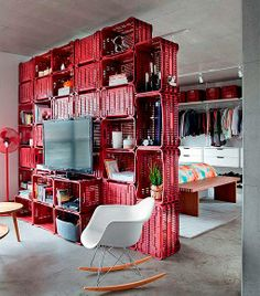 Crates used as room divider and deco in a apartment in plastics architecture with repurposed decoration plastic crates Fabric Room Dividers, Wooden Room Dividers, Portable Room Dividers, Bamboo Room Divider, Glass Room Divider, Living Room Divider, Folding Room Dividers, Wall Dividers, Room Divider Bookcase