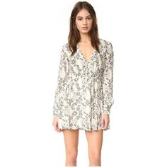 Free People Stealing Fire Mini Dress ($130) ❤ liked on Polyvore featuring dresses, ivory combo, floral dresses, long-sleeve mini dress, long sleeve mini dress, short white dresses and white long-sleeve dresses