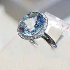 aquamarine ring - this is really pretty. Who says engagement rings have to be diamonds?