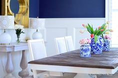 Bring in pops of color. The color scheme in this blue and white room is simple, but when you add bright floral it will make the blue and white colors stronger. The flowers will give it the pop that the room needs. Sponsored by Happy by Design