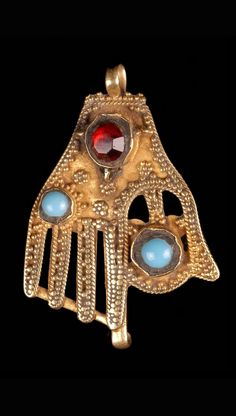 Iraq   Pendant (Kaff) in the form of a hand; gold, turquoise and glass   Possibly Jewish craftsmanship