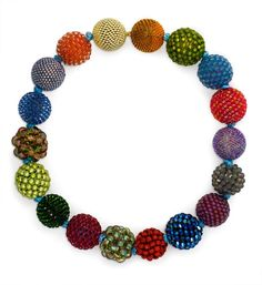 A necklace of 18 handmade glass crystal beads and dichroic glass in multicolor, in 18k. Axel Russmeyer