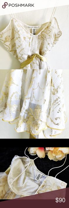 DIANE VON FURSTENBERG SILK TOP DVF ivory and gold asymmetrical tank top with gold ties. Tops shell is 100% silk. Lining is 95%silk 5% Lycra. Beautiful top in excellent condition! Diane Von Furstenberg Tops Blouses