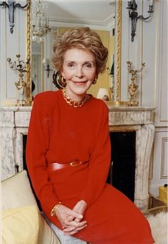 Republican red: Dynasty meets Golden Girls chic, in her trademark shade of Republican red (with plenty of bling) at Claridge's in 1989.