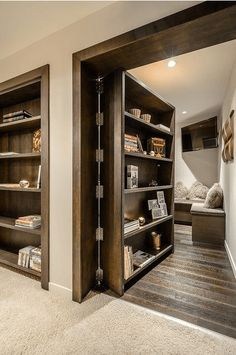 Secret doors... that hold storage.. books...then enter into bedrooms.. all along hallway.. design from Spain...source unknown