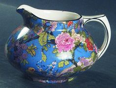 Crown Ducal Blue Chintz Pattern (# 1185) Creamer (c. 1926) | Transfer pattern featuring exotic birds, flowers and foliage on a deep blue background finished with a black trim | #crown_ducal #chintz