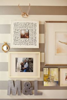 Love the frames on a striped wall
