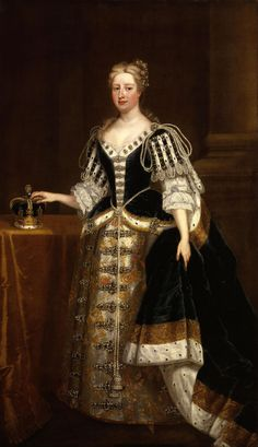Queen Caroline ,the wife of George II, in the robes she wore at the coronation in 1727 . The Queen has adhered to the style worn by Queen Mary II - perhaps in a conscious effort to suggest a connection to the Stuarts (George I had been chosen by Parliament despite being something like the 60th in line to the throne- unlike all those unlucky Stuart claimants George was a Protestant).