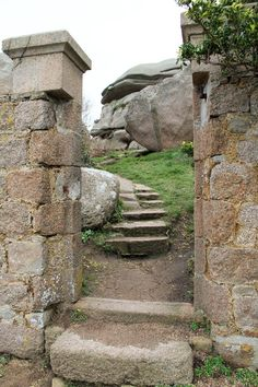 fairy tale land walking through pink granite boulders in brittany, france
