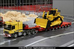 https://flic.kr/p/MpFkZN | LEGO World 2016 | The Scale Modelers Association at LEGO World 2016. Quite a lot of new models and a larger display.   Mercedes Benz Actros truck and trailer by Jaap Kroon (Jaaptechnic) and CAT D11T by Davy Linden.