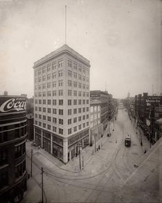 The current, 10 Story, Lowell Sun building under construction at 8 Merrimack Street, corner of Middlesex and Prescott Streets nears completion (1912). The first floor doors remain uninstalled. Also shown is Nelson's Colonial Department Store, Frederick E. Nelson Company Proprietors, at the corner of Merrimack and Central and the rest of Merrimack Street to City Hall.  are the restaurant, 'Putnam Dining Rooms', operated by Frank E. Putnam at 10 Merrimack and Albert E. O'Hare's Furniture…