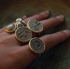 Karen Liberman antique Roman coins gold rings and raw diamond ring.