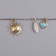 Sophie Harley Necklace   Sun, surfboard & heart charms
