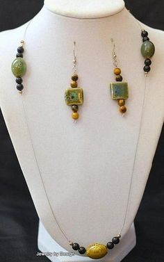 Tiger eye beads and ceramic beads on a single wire necklace