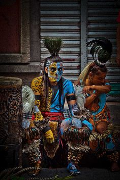 Portrait of Mayan warriors with painted body (street performers), Mexico City, Mexico by anthony pappone