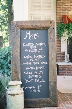 The large wood frame is very appealing as a frame for the chalk Menu.  The milk can, brick facade, and the plants all make this Yummy ..z