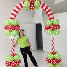 Glamorous green, red and white balloon as arc for Christmas kids party.