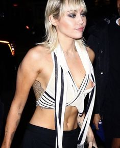 Miley Cyrus suffered a bit of a wardrobe malfunction as she left the Marc Jacobs show during New York Fashion Week on Wednesday. Miley Cyrus, Black And White Blouse, Black Bralette, Taxi Driver, Platinum Blonde, Female Singers, My Baby Girl, Marc Jacobs, Celebs