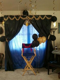 Hollywood party photo opp backdrop. Plastic tablecloths, pinned on trim from JoAnne's fabrics, and a few balloons-elegant!!
