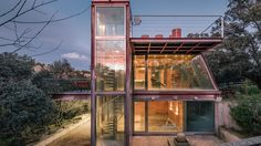 #Architecture: Unusual glass house makes room for nature. A glass house is one of those ideas that's hard to get right, often resulting in the kind of home that only an extrovert could live in. The recently-completed Hidden Pavilion offers an example of how this doesn't have to be the case, however, and besides being a practical home, has some nice little touches, such as a design intended to allow the site's existing trees to grow unimpeded.