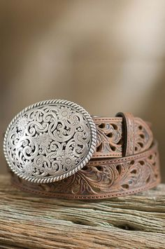 Bring a vintage, Old West flair to any outfit with this artfully crafted full-grain leather belt by Tony Lama.