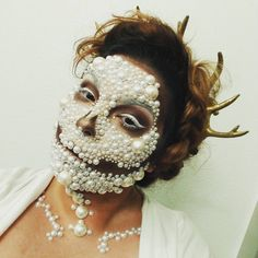 International professional makeup artist Nicki Buglewicz created this Pearl & Crystal Sugar Skull look with Golden Antler Crown with sepia and golden tones for contouring.
