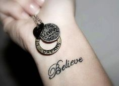 Quote tattoo about believe on wrist