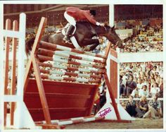"Will Simpson on The Roofer go  7'5"" at Arlington Park race track in 1976.  It was 1976. Will Simpson was 17. The Roofer was a 15.3-hand Thoroughbred and a former children's hunter. Simpson went on to quite a career himself, earning team gold with the U.S. team at the 2008 Olympic Games in Hong Kong aboard Carlsson vom Dach."