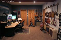 If a man is going to work from home, you might as well have your office filled will with multiple monitors and guitars on the wall. #guitars #homeoffice #men