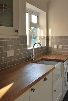 belfast sink, grey subway tiles. Love love love this warm grey kitchen just what I would like