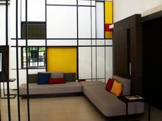 """Mondrian inspired interior - """"Every true artist has been inspired more by the beauty of lines and color and the relationships between them than by the concrete subject of the picture."""""""