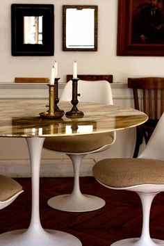 How about a tulip table with a gold leaf table top....a marvelous union between vintage and glam! I love it!